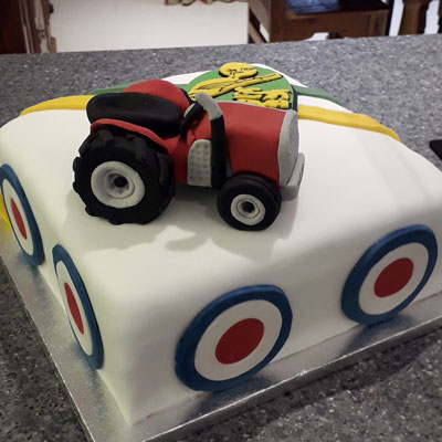 tractor handcrafted birthday celebration cake by Sweet Green Icing