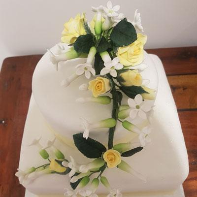 sugar floristry cake on wedding cake by Sweet Green Icing