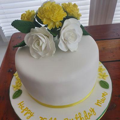Sugar floristry on birthday cake by Sweet Green Icing Dereham